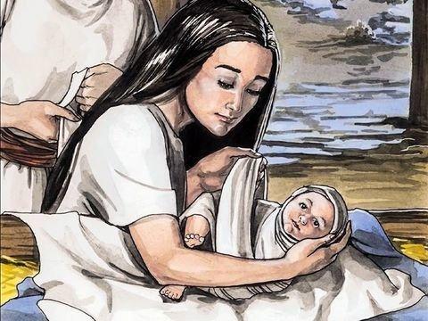 Maria envolve o bebê Jesus em alguns panos e coloca-o numa manjedoura